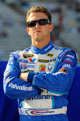 FORT WORTH, TX - APRIL 08:  A.J. Allmendinger, driver of the #43 Valvoline Ford, stands on the grid during qualifying for the NASCAR Sprint Cup Series Samsung Mobile 500 at Texas Motor Speedway on April 8, 2011 in Fort Worth, Texas.  (Photo by Jared C. Ti