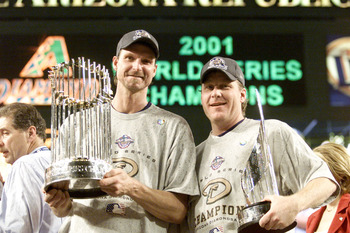 4 Nov 2001:  Co-MVP winners Randy Johnson #51 and Curt Schilling #38 of the Arizona Diamondbacks hold the trophys after winning the  World Series over the New York Yankees at Bank One Ballpark in Phoenix, Arizona. The Diamondbacks defeated the Yankees 3-2