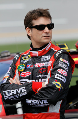 TALLADEGA, AL - APRIL 16:  Jeff Gordon, driver of the #24 Drive to End Hunger/AARP Chevrolet, stands on the grid during qualifying for the NASCAR Sprint Cup Series Aaron's 499 at Talladega Superspeedway on April 16, 2011 in Talladega, Alabama.  (Photo by