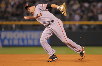 DENVER, CO - APRIL 18:  Second baseman Freddy Sanchez #21 of the San Francisco Giants throws out a runner against the Colorado Rockies at Coors Field on April 18, 2011 in Denver, Colorado.  (Photo by Doug Pensinger/Getty Images)