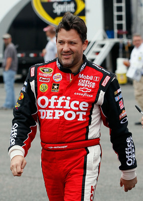 TALLADEGA, AL - APRIL 15:  Tony Stewart, driver of the #14 Office Depot/Mobil 1 Chevrolet, walks in the garage area during practice for the NASCAR Sprint Cup Series Aaron's 499 at Talladega Superspeedway on April 15, 2011 in Talladega, Alabama.  (Photo by