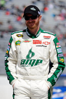 MARTINSVILLE, VA - APRIL 02:  Dale Earnhardt Jr., driver of the #88 Amp Energy/National Guard Chevrolet, walks on the grid during qualifying for the NASCAR Sprint Cup Series Goody's Fast Relief 500 at Martinsville Speedway on April 2, 2011 in Martinsville