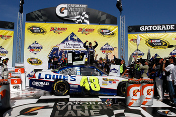 TALLADEGA, AL - APRIL 17:  Jimmie Johnson, driver of the #48 Lowe's Chevrolet, celebrates in Victory Lane after winning the NASCAR Sprint Cup Series Aaron's 499 at Talladega Superspeedway on April 17, 2011 in Talladega, Alabama.  (Photo by Jason Smith/Get