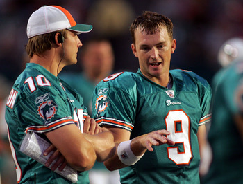 MIAMI - AUGUST 09:  Quarterback Chad Pennington #10 of the Miami Dolphins chats with quarterback John Beck #9 during a pre season game against the Tampa Bay Buccaneers August 9, 2008 at Dolphin Stadium in Miami, Florida.  (Photo by Marc Serota/Getty Image