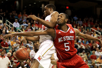 GREENSBORO, NC - MARCH 10:  Dino Gregory #33 of the Maryland Terrapins blocks a shot by C.J. Leslie #5 of the North Carolina State Wolfpack during the second half of the game in the first round of the 2011 ACC men's basketball tournament at the Greensboro