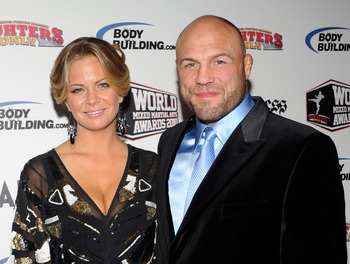 LAS VEGAS, NV - DECEMBER 01:  Annie Stanley (L) and mixed martial artist and actor Randy Couture arrive at the third annual Fighters Only World Mixed Martial Arts Awards 2010 at the Palms Casino Resort December 1, 2010 in Las Vegas, Nevada.  (Photo by Eth