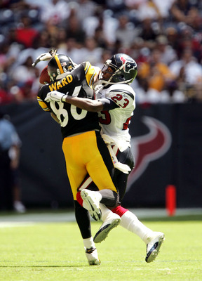 HOUSTON - SEPTEMBER 18:  Cornerback Dunta Robinson #23 of the Houston Texans breaks up a pass intende for wide receiver Hines Ward #86 of the Pittsburgh Steelers on September 18, 2005 at Reliant Stadium in Houston, Texas. The Steelers won 27-7.  (Photo by