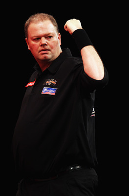 LONDON, ENGLAND - JANUARY 01:  Raymond van Barneveld of The Netherlands reacts during his match against Gary Anderson of England during the quarter finals of the 2011 Ladbrokes.com World Darts Championship at Alexandra Palace on January 1, 2011 in London,