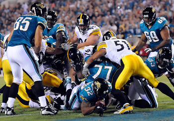 JACKSONVILLE, FL - OCTOBER 05:  Maurice Jones-Drew #32 of the Jacksonville Jaguars scores a touchdown in a game against the Pittsburgh Steelers at Jacksonville Municipal Stadium on October 5, 2008 in Jacksonville, Florida.  (Photo by Sam Greenwood/Getty I