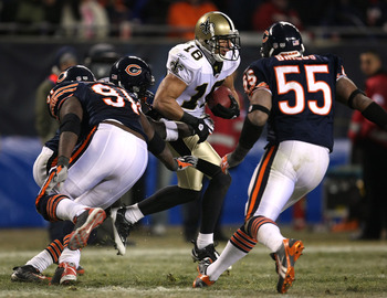 CHICAGO - DECEMBER 11:  Lance Moore #16 of the New Orleans Saints runs with the ball against Tommie Harris #91 and Lance Briggs #55 of the Chicago Bears at Soldier Field on December 11, 2008 in Chicago, Illinois.  (Photo by Jonathan Daniel/Getty Images)