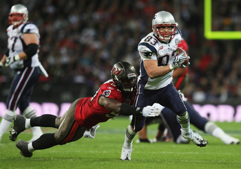 LONDON, ENGLAND - OCTOBER 25:  Wes Welker (#83) of the New England Patriots is tackled by Adam Hayward (#57) of Tampa Bay Buccaneers during the NFL International Series match between New England Patriots and Tampa Bay Buccaneers at Wembley Stadium on Octo