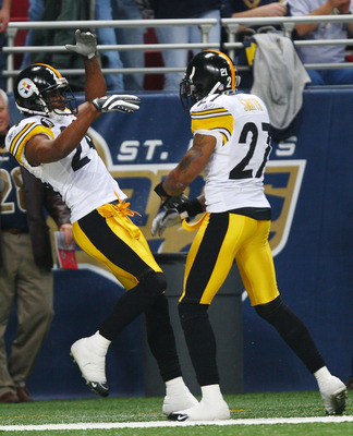 ST. LOUIS - DECEMBER 20:   Ike Taylor #24 of the Pittsburgh Steelers is congratulated by teammate Anthony Smith #27 after Taylor intercepted a pass and ran it in for a touchdown againt St. Louis Rams in the fourth quarter on December 20, 2007 at Edward Jo