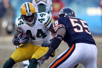 CHICAGO, IL - JANUARY 23:  James Starks #44 of the Green Bay Packers runs the ball as he makes a move on Lance Briggs #55 of the Chicago Bears in the NFC Championship Game at Soldier Field on January 23, 2011 in Chicago, Illinois.  (Photo by Jonathan Dani