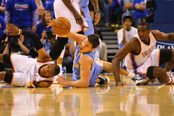 OKLAHOMA CITY, OK - APRIL 17: Russell Westbrook #0 and Serge Ibaka #9 both of the Oklahoma City Thunder look to beat Danilo Gallinari #8 of the Denver Nuggets to a loose ball in Game One of the Western Conference Quarterfinals in the 2011 NBA Playoffs on