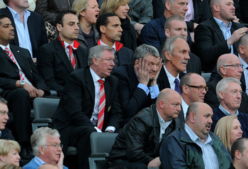 NEWCASTLE UPON TYNE, ENGLAND - APRIL 19:  Manchester United Manager Sir Alex Ferguson looks on from the stands with Chief Executive David Gill during the Barclays Premier League match between Newcastle United and Manchester United at St James' Park on Apr