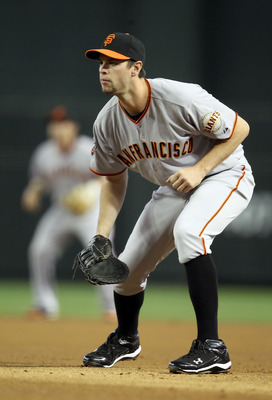 PHOENIX, AZ - APRIL 17:  Infielder Brandon Belt #9 of the San Francisco Giants in action during the Major League Baseball game against the Arizona Diamondbacks at Chase Field on April 17, 2011 in Phoenix, Arizona.  (Photo by Christian Petersen/Getty Image