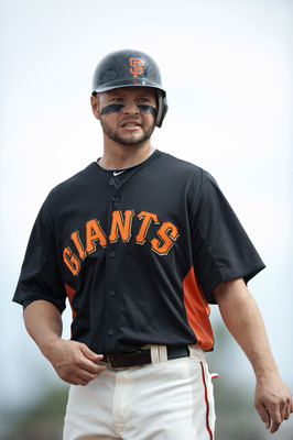SCOTTSDALE, AZ - FEBRUARY 25: Cody Ross #13 of the San Francisco Giants looks on during a spring training game against the Arizona Diamondbacks at Scottsdale Stadium on February 25, 2011 in Scottsdale, Arizona. (Photo by Rob Tringali/Getty Images)