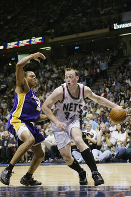 EAST RUTHERFORD, NJ - JUNE 12:  Keith Van Horn #44 of the New Jersey Nets drives around Devean George #3 in Game four of the 2002 NBA Finals against of the Los Angeles Lakers on June 12, 2002 at Continental Airlines Arena in East Rutherford, New Jersey. T