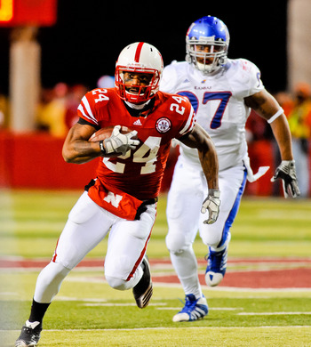 LINCOLN, NE - NOVEMBER 13: Niles Paul #24 of the Nebraska Cornhuskers finishes off a reception against the Kansas Jayhawks during their game at Memorial Stadium on November 13, 2010 in Lincoln, Nebraska. Nebraska Defeated Kansas 20-3. (Photo by Eric Franc