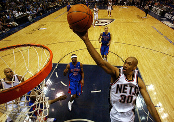 EAST RUTHERFORD, NJ - MAY  9:  Kerry Kittles #30 goes up for a layup against the Detroit Pistons in game three of the Eastern Conference Semifinals May 9, 2004 at Continental Airlines Arena in East Rutherford, New Jersey. The Nets won 82-64.  (Photo by Ez