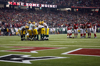 ATLANTA, GA - JANUARY 15:  The Green Bay Packers offense huddles up against the Atlanta Falcons defense during their 2011 NFC divisional playoff game at Georgia Dome on January 15, 2011 in Atlanta, Georgia.  (Photo by Streeter Lecka/Getty Images)