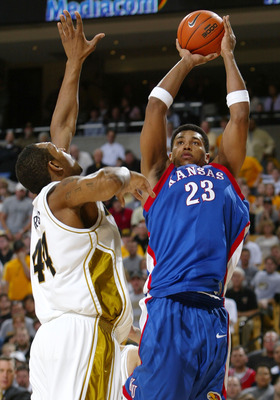 COLUMBIA, MO - MARCH 6:  Wayne Simien #23 of the Kansas Jayhawks takes a shot as Kalen Grimes #44 of the Missouri Tigers defends on March 6, 2005 at Mizzou Arena in Columbia, Missouri.  (Photo by Elsa/Getty Images)