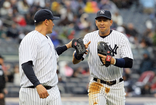 NEW YORK, NY - APRIL 16:  Freddy Garcia #36 and Alex Rodriguez #13 of the New York Yankees celebrate the final out of an inning against the Texas Rangers on April 16, 2011 at Yankee Stadium in the Bronx borough of New York City.  (Photo by Jim McIsaac/Get