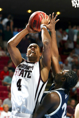 ORLANDO, FL - MARCH 21:  Lawrence Roberts #4 of the Mississippi State Bulldogs shoots over Anthony Myles #24 of the Xavier Muskateers during the second round game of the NCAA Division I Men's Basketball Tournament on March 21, 2004 at TD Waterhouse Centre