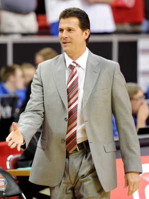 LAS VEGAS, NV - MARCH 11:  Head coach Steve Alford of the New Mexico Lobos greets players before his team's 87-76 loss to the Brigham Young University Cougars in a semifinal game of the Conoco Mountain West Conference Basketball tournament at the Thomas &