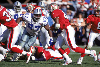 SAN FRANCISCO - NOVEMBER 13:  Defensive back Russell Maryland #67 of the Dallas Cowboys goes after full back William Floyd #40 of the San Francisco 49ers during a game at Candlestick Park on November 13, 1994 in San Francisco, California.  The 49ers won 2