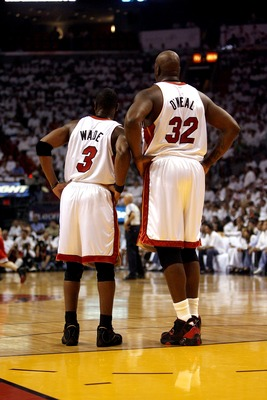 MIAMI - APRIL 27: Dwyane Wade #3 and teammate Shaquille O'Neal #32 of the Miami Heat stand together during a timeout against the Chicago Bulls in Game Three of the Eastern Conference Quarterfinals during the 2007 NBA Playoffs at American Airlines Arena on
