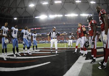ATLANTA - AUGUST 22: Referee Ron Winter tosses the coin as the Atlanta Falcons host the Tennessee Titans at the Georgia Dome on August 22, 2008 in Atlanta, Georgia.  (Photo by Al Messerschmidt/Getty Images)