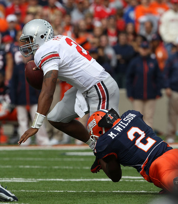 CHAMPAIGN, IL - OCTOBER 02: Terrelle Pryor #2 of the Ohio State Buckeyes is brought down by Martez Wilson #2 of the Illinois Fighting Illini at Memorial Stadium on October 2, 2010 in Champaign, Illinois. Ohio State defeated Illinois 24-13. (Photo by Jonat