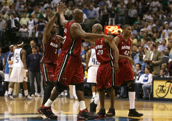 DALLAS - JUNE 20:  Dwyane Wade #3, Shaquille O'Neal #32, Gary Payton #20 and James Posey #42 of the Miami Heat celebrate together during a timeout against the Dallas Mavericks in game six of the 2006 NBA Finals on June 20, 2006 at American Airlines Center