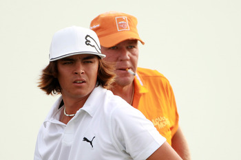KOHLER, WI - AUGUST 10:  (L-R) Rickie Fowler and John Daly look on during a practice round prior to the start of the 92nd PGA Championship on the Straits Course at Whistling Straits on August 10, 2010 in Kohler, Wisconsin.  (Photo by Andrew Redington/Gett