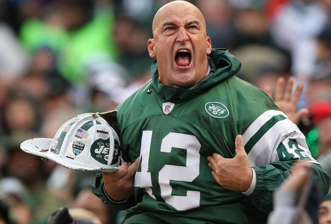 EAST RUTHERFORD, NJ - OCTOBER 18:  New York Jets fan fireman Ed Anzalone cheers during the game between The New York Jets against The Buffalo Bills on October 18, 2009 at Giants Stadium in East Rutherford, New Jersey.  (Photo by Al Bello/Getty Images)