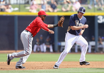 PEORIA, AZ - MARCH 15:  Infielder Erick Aybar #2 of the Los Angeles Angels of Anaheim tags out Brad Hawpe #11 of the San Diego Padres during the third inning of the spring training game at Peoria Stadium on March 15, 2011 in Peoria, Arizona.  (Photo by Ch