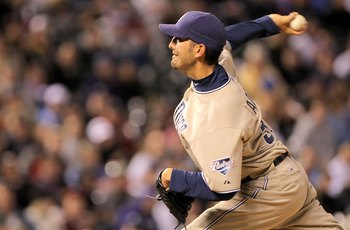 DENVER - APRIL 10:  Relief pitcher Mike Adams #37 of the San Diego Padres delivers against the Colorado Rockies during MLB action at Coors Field on April 10, 2010 in Denver, Colorado. The Padres defeated the Rockies 5-4 in 14 innings.  (Photo by Doug Pens