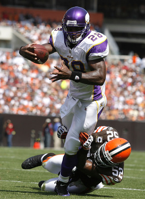 CLEVELAND - SEPTEMBER 13:  Adrian Peterson #28 of the Minnesota Vikings is hit by D'Qwell Jackson #52 of the Cleveland Brwons at Cleveland Browns Stadium on September 13, 2009 in Cleveland, Ohio.  (Photo by Matt Sullivan/Getty Images)