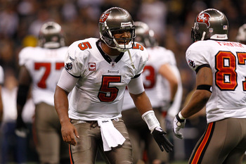 NEW ORLEANS, LA - JANUARY 02:  Quarterback Josh Freeman #5 talks with Preston Parker #87 of the Tampa Bay Buccaneers during the game against the New Orleans Saints at the Louisiana Superdome on January 2, 2011 in New Orleans, Louisiana.   The Buccaneers d