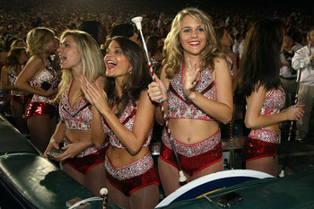 PASADENA, CA - JANUARY 07:  Cheerleaders of the Alabama Crimson Tide are seen in the stands during the Citi BCS National Championship game against the Texas Longhorns at the Rose Bowl on January 7, 2010 in Pasadena, California.  (Photo by Stephen Dunn/Get