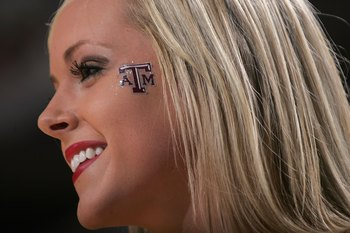 DALLAS - MARCH 11:  A Texas A&M Aggies cheerleader smiles during the game against the Texas Longhorns against during the semifinals round of the Phillips 66 Big 12 Men's Basketball Championship Tournament at American Airlines Arena on March 11, 2006 in Da