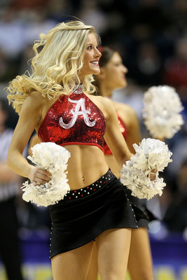 NASHVILLE, TN - MARCH 11:  A cheerleader from the Alabama Crimson Tide performs against the South Carolina Gamecocks during the first round of the SEC Men's Basketball Tournament at the Bridgestone Arena on March 11, 2010 in Nashville, Tennessee.  (Photo