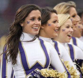 SEATTLE - NOVEMBER 28: Washington Huskies cheerleaders perform during the Apple Cup game against the Washington State Cougars on November 28, 2009 at Husky Stadium in Seattle, Washington. The Huskies defeated the Cougars 30-0. (Photo by Otto Greule Jr/Get