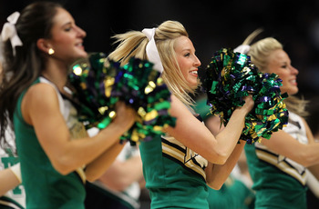 CHICAGO, IL - MARCH 18:  The Notre Dame Fighting Irish cheerleaders perform during the game against the Akron Zips in the second round of the 2011 NCAA men's basketball tournament at the United Center on March 18, 2011 in Chicago, Illinois.  (Photo by Jam
