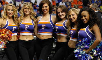 TAMPA, FL - MARCH 19:  Cheerleaders for the Florida Gators pose for a photo against the UCLA Bruins during the third round of the 2011 NCAA men's basketball tournament at St. Pete Times Forum on March 19, 2011 in Tampa, Florida.  (Photo by J. Meric/Getty