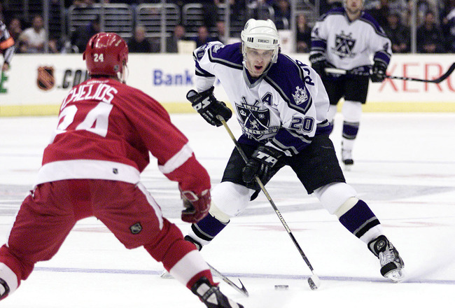 23 Apr 2001: Luc Robitaille #20 of the Los Angeles Kings moves the puck against the defense of Chris Chelios #20 of the Detroit Red Wings in Game Six of the NHL Western Conference Playoffs Quarterfinals at the Staples Center in Los Angeles, California. DI