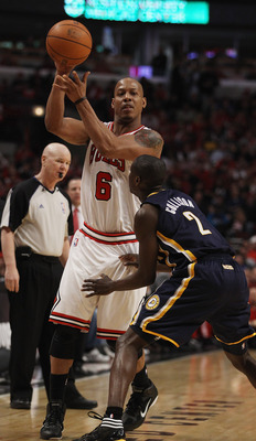 CHICAGO, IL - APRIL 16: Keith Bogans #6 of the Chicago Bulls looks to pass over Darren Collison #2 of the Indiana Pacers in Game One of the Eastern Conference Quarterfinals in the 2011 NBA Playoffs at the United Center on April 16, 2011 in Chicago, Illino