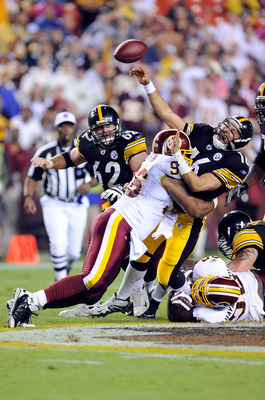 LANDOVER, MD - AUGUST 22:  Charlie Batch #16 of the Pittsburgh Steelers is hit by Cornelius Griffin #96 of the Washington Redskins at Fed Ex Field on August 22, 2009 in Landover, Maryland.  (Photo by Greg Fiume/Getty Images)