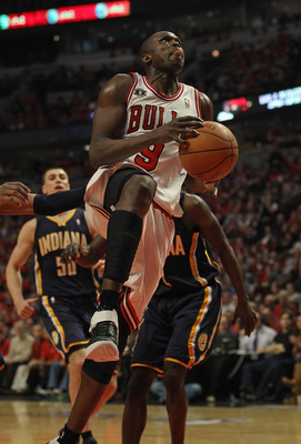 CHICAGO, IL - APRIL 16: Loul Deng #9 of the Chicago Bulls drives to the basket against the Indiana Pacers in Game One of the Eastern Conference Quarterfinals in the 2011 NBA Playoffs at the United Center on April 16, 2011 in Chicago, Illinois. The Bulls d